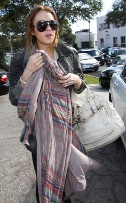 Lindsey Lohan Makes An Escape.  Photo: Flynetonline.com
