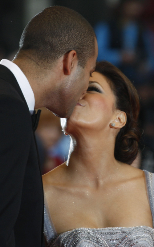 Eva Longoria Parker & Tony Parker.  Photo:  REUTERS/Jean-Paul Pelissier
