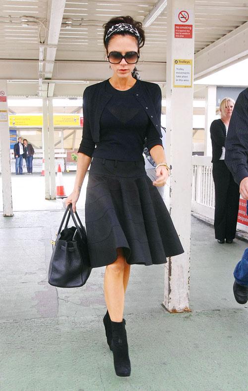 Victoria Beckham; Airport Fashion Queen.  Photo: Bauer-Griffen.com