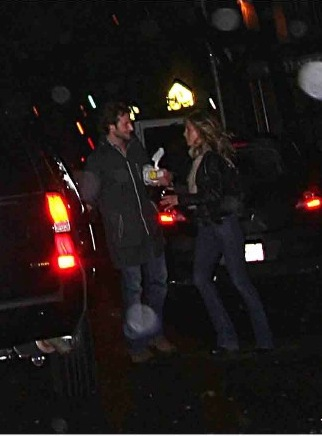 Bradley Cooper & Jennifer Aniston.  Photo: Splashnewsonline.com/The Examiner