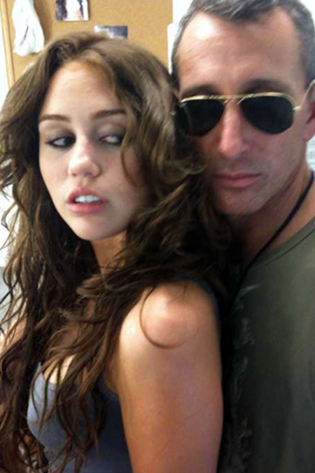 Miley Cyrus provocative picture taken with her director Adam Shankman twitter.com