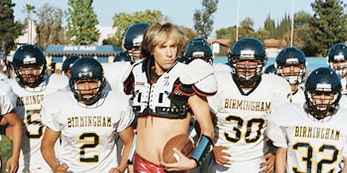 Sacha Baron Cohen As Bruno With High School Football Team.  Photo: GQ Magazine