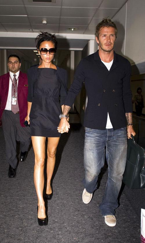 Victoria & David Beckham  At Heathrow Airport.  Photo: Flynetonline.com