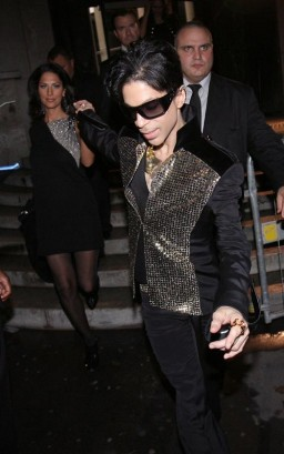 Prince Attends Yves Saint Laurent Fashion Show. Photo: Flynetonline.com