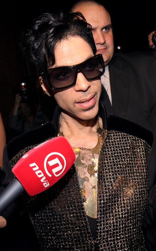 Prince Attends Yves Saint Laurent Fashion Show Photo: Flynetonline.com