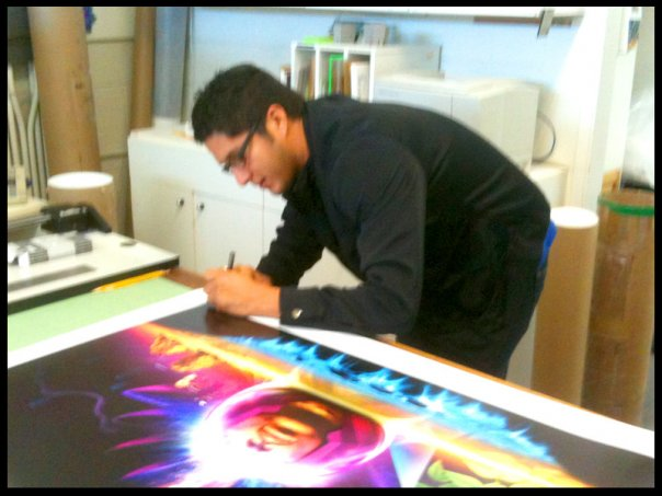 Anthony Malzone Signing The Art of Prince Artwork.  Photo: Anthony Malzone