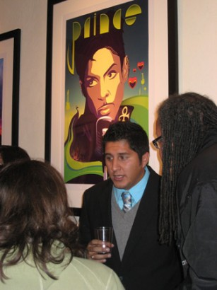 Artist Anthony Malzone talks to fans in front of the Monaco print