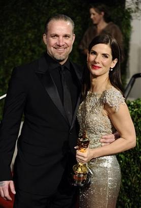 Sandra Bullock with husband Jesse James at the Vanity Fair Oscar Party, March 7, 2010 | AP Photo/Peter Kramer
