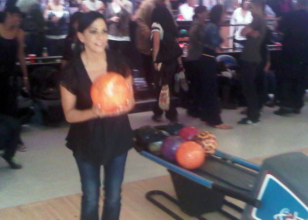 Sheila E. gets ready to bowl a strike
