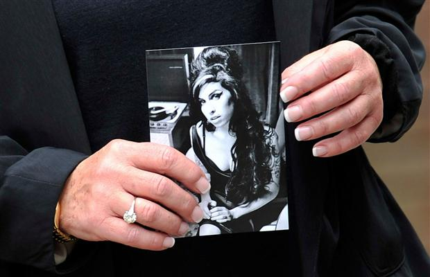 A Fan Of Winehouse&#039;s Holding Her Photo Outside Funeral Location. Photo: Gareth Cattermole, Getty Images