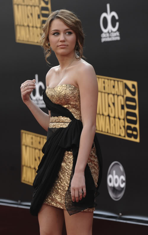 Miley Cyrus Looks Like She Rather Be Elsewhere.  Photo: Wireimage.com