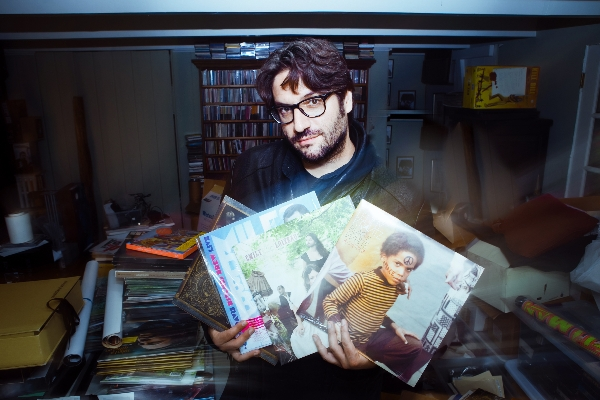 Mathieu Bitton  in his vinyl and poster storage in L.A., handling some of the records he's recently designed Photo: Polina Rabtseva