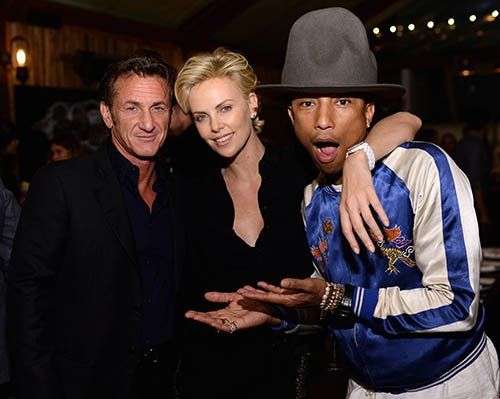 Sean Penn, Charlize Theron, & Pharrell Photo: GettyImages.com